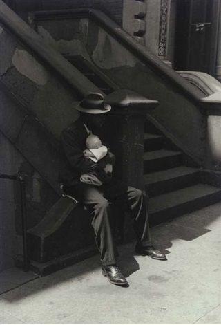 Man on stoop holding baby , 1952 Roy DeCarava.jpg