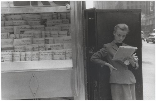 Elbowing an Out of Town Newsstand - 1954.jpg