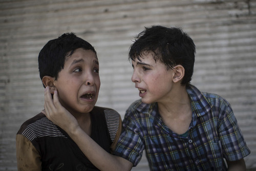 Zeid Ali, 12, left, and Hodayfa Ali, 11, comfort e