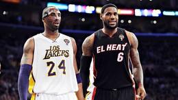 Kobe Bryant e LeBron James com camisolas alusivas à